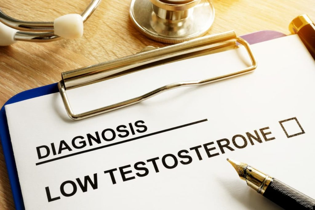 Diagnosis Low testosterone and pen on a desk - Does a Carnivore Diet Increase Testosterone