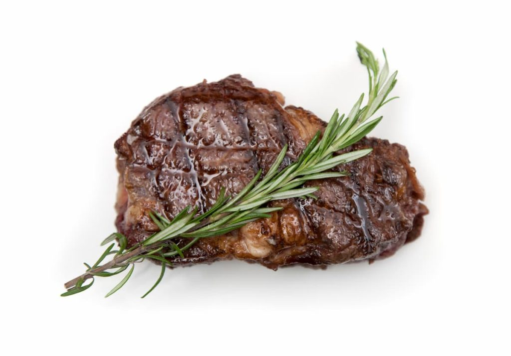 Cooked Ribeye with rosemary - How To Do The Carnivore Diet on a Budget
