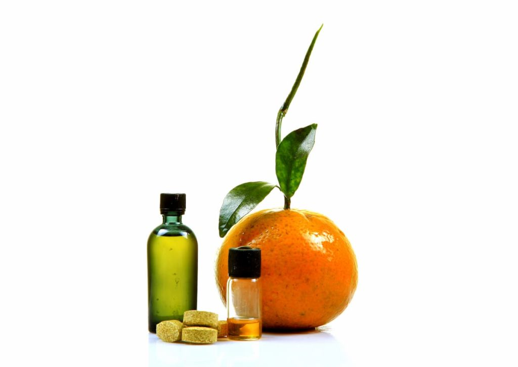 How Do Carnivores Get Vitamin C - Vitamin c tablets and liquid bottles with orange slices