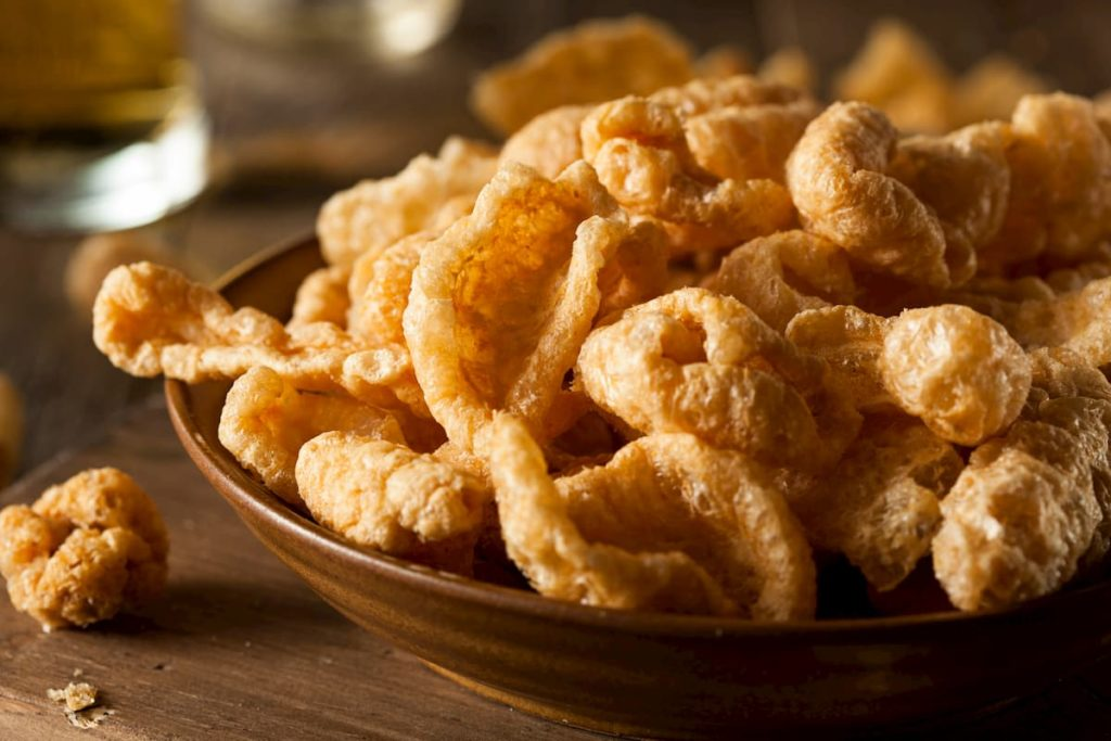 Pork rinds on a table in a bowl for snacking - Pork Rinds on Carnivore Diets