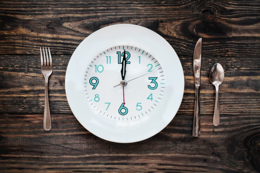 Clock on a plate as intermittent fasting requires attention to time - Should You Fast on Carnivore Diets