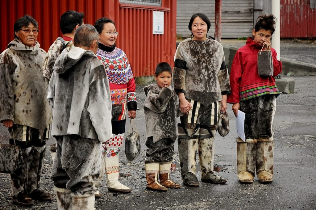 Aboriginal native eskimo people in a group waiting to welcome visitors to Nanortalik, Greenland - Can a Human Survive Eating Only Meat